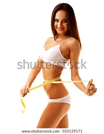 Woman measuring perfect shape of beautiful thigh isolated on white background - stock photo