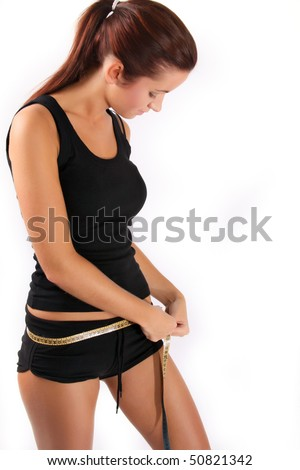 Woman measuring perfect shape of beautiful thigh. She lose five kilograms in weight - stock photo