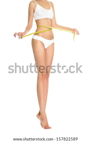 Woman measuring perfect shape of beautiful toned waist healthy isolated on white background. Perfect Slim Body. Diet