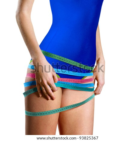 woman measuring shape of beautiful thigh healthy lifestyles concept - stock photo