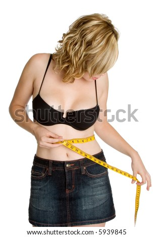 Woman Measuring Waist - stock photo