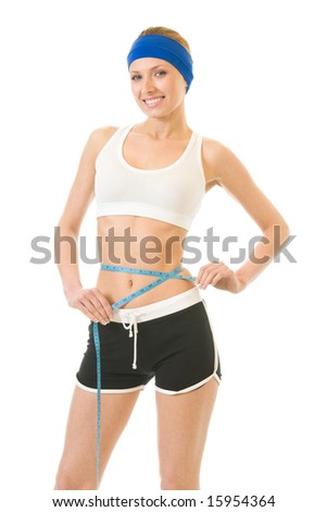 Woman measuring waist with a tape measure, isolated on white - stock photo