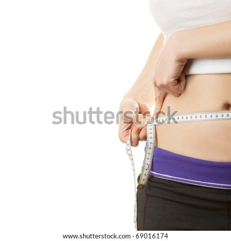 Woman measuring waistline with a tape isolated on white background - stock photo
