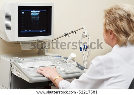 woman medic doctor in uniform using ultrasound system for thyroid diagnosis - stock photo