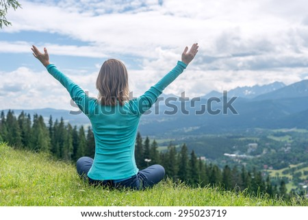 Woman Meditate at the Mountains - stock photo