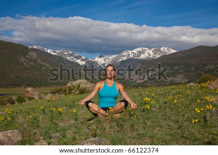 Woman meditates in the Colorado Rocky Mountains - stock photo