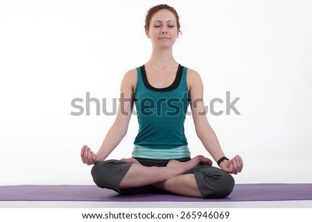 Woman meditating and doing yoga against white background. - stock photo