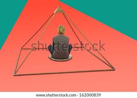 Woman meditating and making yoga in metal pyramid - stock photo