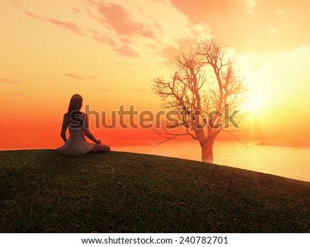 woman meditating at sunrise - stock photo