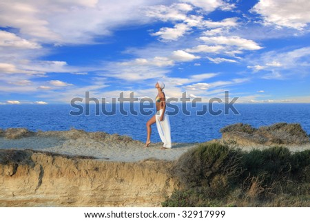 Woman meditating at sunset in Greece - stock photo