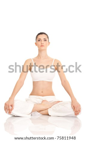 woman meditating in lotus position on floor on white background - stock photo
