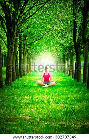 Woman meditating in nature  - stock photo
