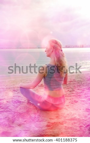 Woman meditating in the sitting yoga position on the ocean coast at a daylight. Zen, meditation, peace. - stock photo