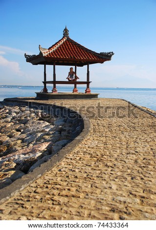 Woman meditating on free air - stock photo