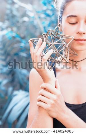 Woman meditating on sacred geometry - stock photo