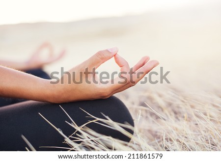 Woman meditating practicing yoga outdoors - stock photo