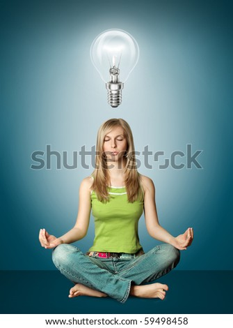 woman meditation in lotus pose with bulb isolated - stock photo