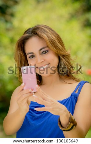 Woman messaging on her smart phone - stock photo