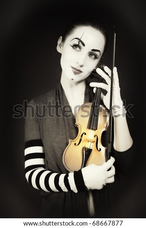 woman mime playing the violin. vintage