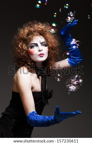 woman mime with soap bubbles. - stock photo