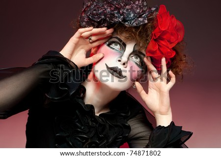 Woman mime with theatrical makeup. Studio shot. - stock photo