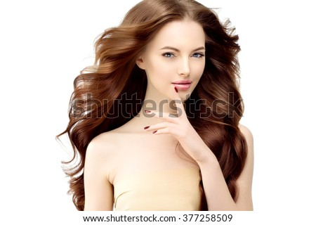Woman Model with long wavy hair. Waves Curls Hairstyle. Hair Salon. Updo. Fashion model with shiny hair. Girl with healthy hair girl with luxurious haircut. Hair loss Girl with hair volume. Brunette - stock photo