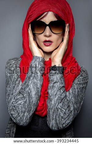 Woman modeling modern Persian fashion with head scarf or Hijab.  The image depicts conservative tradition applied to modern progressive fashion.  - stock photo