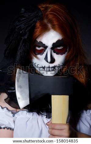 Woman monster with axe in dark room