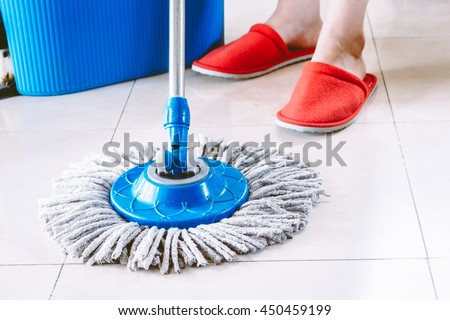 Woman Mopping floor at home - stock photo