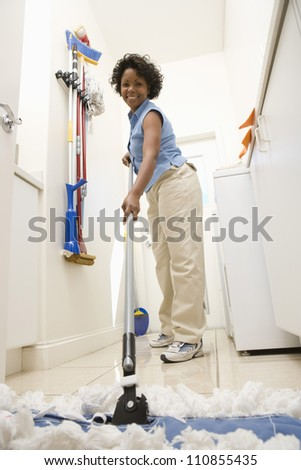 Woman Mopping The Floor - stock photo