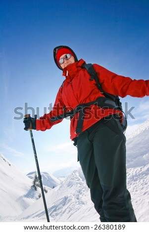 Woman mountainering in mountains covered with snow - stock photo