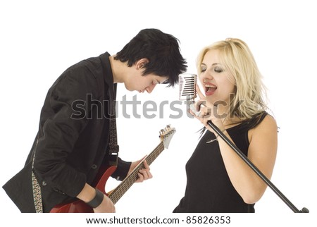 Woman music singer and rocking male guitarist in garage band isolated on white - stock photo