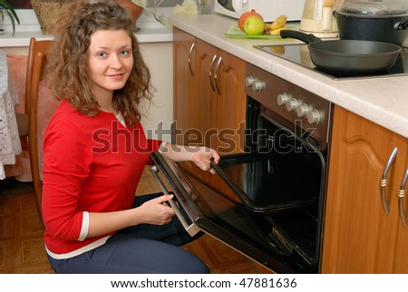 woman near contemporary kitchen oven