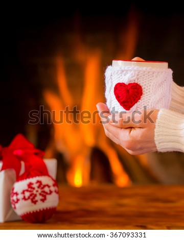 Woman near fireplace. Valentine's day at home. Winter holiday concept