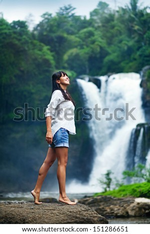 woman near fresh waterfall, bali - stock photo