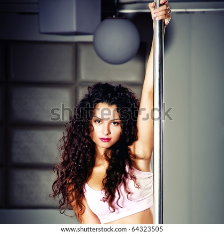 woman near the pole - stock photo