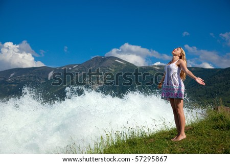 woman near water on background of the beauty landscape, altai - stock photo