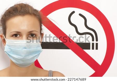 Woman. No smoking concept a no smoking sign - stock photo