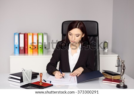 Woman notary public notarizes the power of attorney or other document . Notary public concept - stock photo