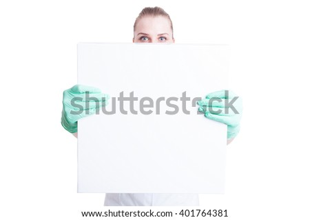 Woman nurse or doctor showing blank or empty  board with text or inscription area isolated on white - stock photo