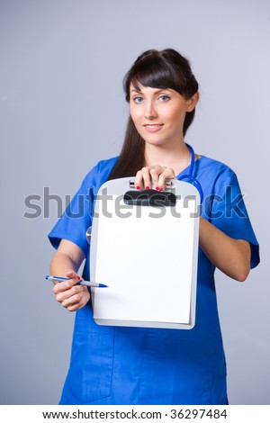 Woman Nurse with chart in modern hospital