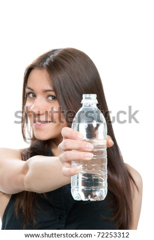 Woman offer and give bottle of pure still drinking water nutrition facts. Female holding in hand sparkling mineral bottled water isolated on a white background. Healthy lifestyle concept - stock photo