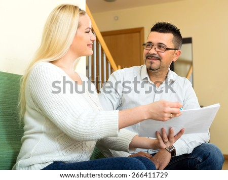 Woman offering a man to fill in a questionnaire
