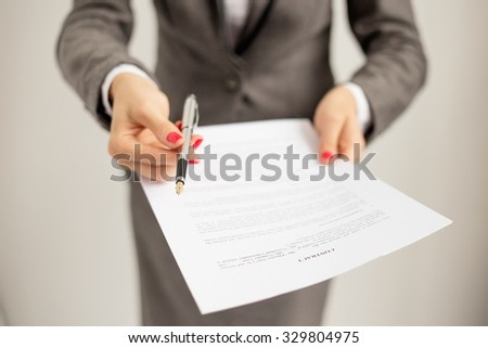 Woman offering to sign papers - stock photo