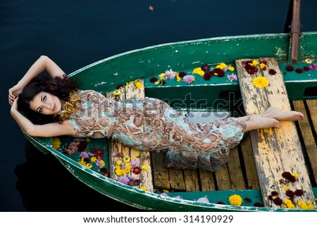 woman on a boat in the autumn - stock photo