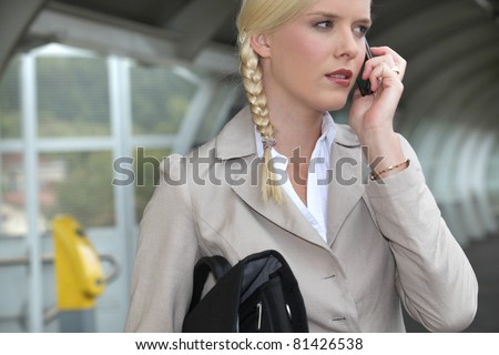 woman on a business travel talking on her cell phone - stock photo