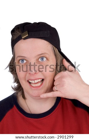 Woman on a comedy hand phone with baseball hat and t-shirt, over white - stock photo
