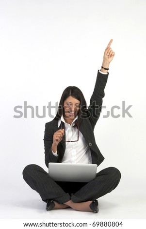 woman on a laptop computer having online success- isolated over a white background - stock photo