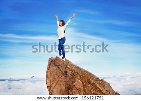 woman on a mountain peak - stock photo