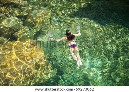 woman on a river at Gredos mountains in Avila Spain - stock photo